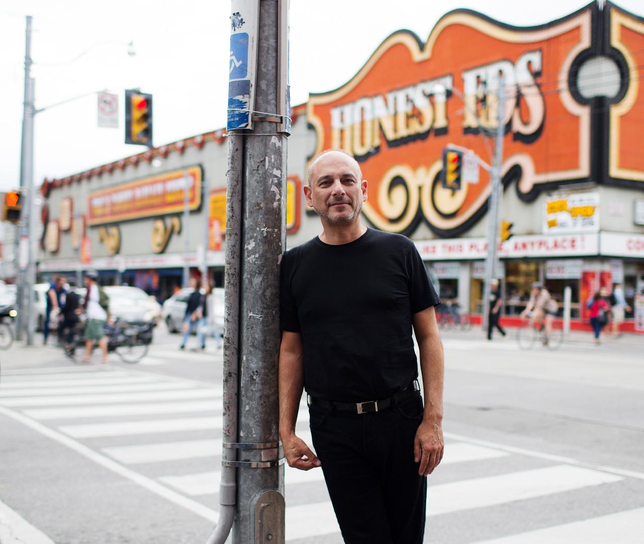 Gregory Henriquez photographed at Honest Ed's site.