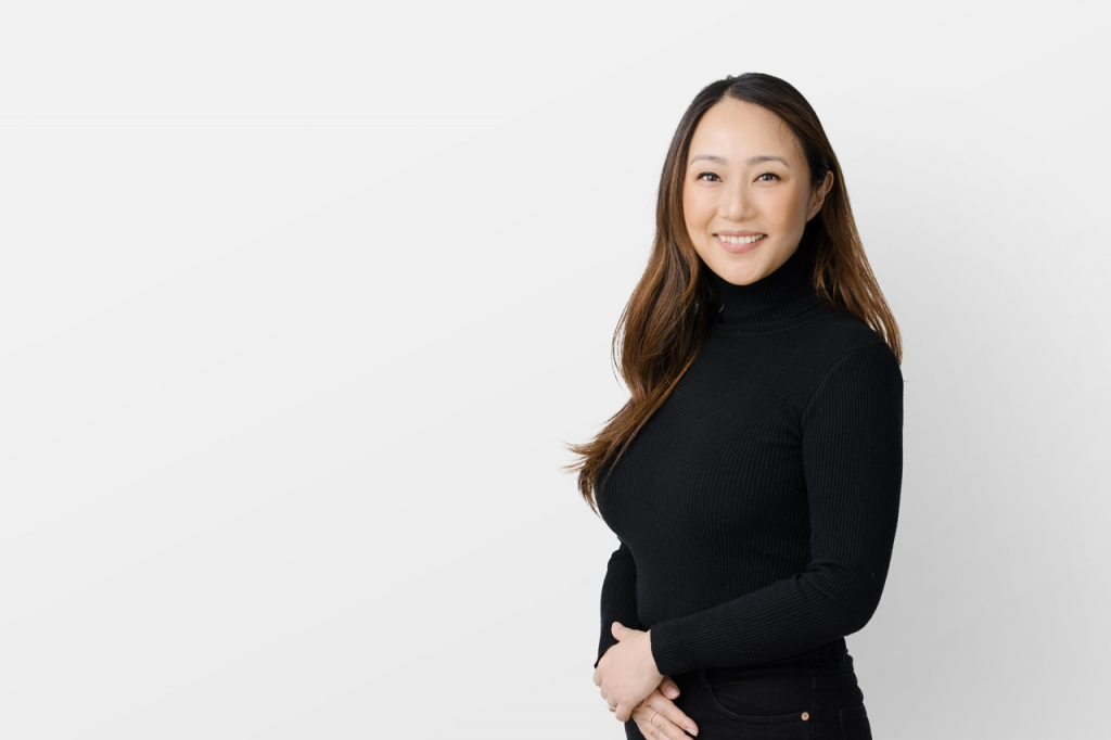 Portrait of Henriquez team member, Carmen Wong, Office & HR Manager